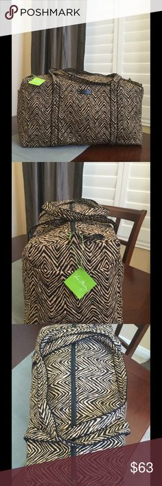 """NWT VERA BRADLEY LARGE DUFFEL Brand new with tags Vera Bradley large duffel  Zebra pattern  15"""" strap drop Handy outside end pocket Folds flat for easy storing Dimensions 22"""" W x 11½"""" H x 11½"""" D - 15"""" strap drop  Smoke/pet free home Vera Bradley Bags Travel Bags"""
