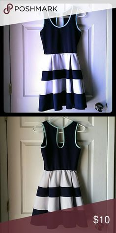 Colorblock strapless dress Poly blend. Navy blue white with teal trim at collar and arm openings. 2 pleats at waist both front and back. Knee length. Dresses