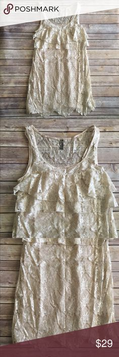 Free People cream lace dress Beautiful Free People cream lace dress. It has tiered lace at the bust and a full lining. Great condition. Measures about 36 inches as round the bust, 33 inches around the waist, and is about 35 inches long. Free People Dresses