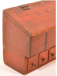 "Conestoga Auctions -  Harry B. Hartman Estate Auction - Session IV  Aug. 15, 2015.  Lot: 637 (side detail).     Estimate:	$800 – $1,200.  Sold: $2,541.     Description:  19th Century Softwood Hanging Seed Box with Original Red Paint. Hinged slant lid enclosing a compartmented interior above a single row of ten graduated drawers. Provenance: Merritt Sale. 8-1/4""h. x 28""w. x 5-3/4""d. Condition: Good with wear."
