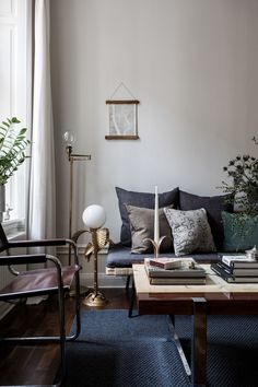 Mid century modern, Scandinavian style interior | Featuring Massimo Grassi leather sling chairs and a marble and chrome coffee table | IKEA Sinnerlig daybed with custom covers | Bemz cushion covers in Sage Rosendal linen and Ivy Malmen velvet