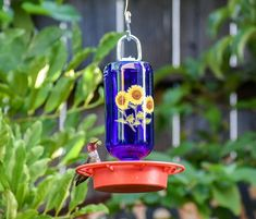 #homeliving #outdoorgardening #feedersbirdhouses #birdfeeder #birdhouse #handmadeitem #giftformom #giftforher #hummingbirdfeeder #birdbath #gardendécor #masonjar #housewarminggift #allseason #yardart #remembrancegifts #hangingbirdfeeder #handmade #glassmasonjar #feedingbirds #giftforwife #cottagecore #outdoors #birdhouse #easytohang #birds Wild Bird Feeders, Hanging Bird Feeders, Cobalt Glass, Cobalt Blue, Bee Free, No Waste, Clear Stickers, Wild Birds, Yard Art