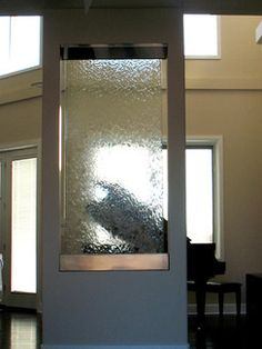 Custom stainless steel and glass indoor waterfall for a home in ...