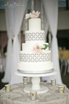 Grey and pink wedding cake with handcrafted sugar magnolias and modern geometric side design. www.honeycrumb.com
