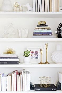 Bookshelfs. You can do no wrong with a bookcase that's brimming with books, but if you haven't quite reached total book nerd status, you can flush out that negative space with a few artful accessories to give your shelves a more polished look: bookends, vases, decorative boxes, framed artwork, sculptural pieces. trevor-tondro. smittenstudio1