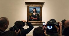 The Mona Lisa has a new twin.  In the process of restoring a painting that has been in Madrid's Museo del Prado since 1819, conservators have discovered a near-exact copy of the famous portrait hidden beneath a black coat of overpaint.