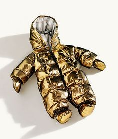 Burberry gold metallic baby snowsuit! My poor children will wear such items someday.