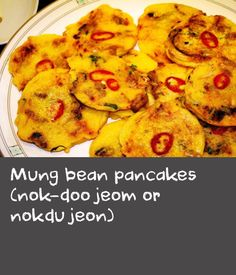 Mung bean pancakes (nok-doo jeom or nokdu jeon) | This recipe from Luke Nguyenis a Korean New Year family favourite. The delicious pan-fried savoury pancakes are made from ground mung beans and topped with chopped vegetables and meat. Serve them as part of a shared meal.