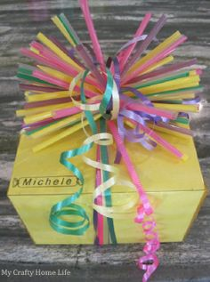 Fun gift wrap with straws and cellophane.