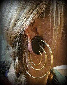 """Wood plugs with three brass rings.  This would solve my, """"I want to gauge my ears but still wear pretty ear rings"""" dilemma."""