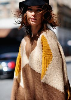 Mustard, cream and brown knit sweater.