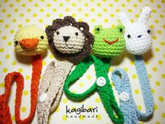 This is a pattern that contains the directions for crocheting four different pacifier holders: a lion, a rabbit, a duck, and a frog.