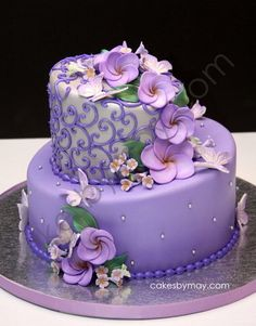 Beautiful and delicate lavender and silver butterflies with frangipanis with a twist of whimsy with the topsy turvy cake design. Beautiful Wedding Cakes, Gorgeous Cakes, Pretty Cakes, Cute Cakes, Amazing Cakes, Unique Cakes, Creative Cakes, Purple Cakes, Adult Birthday Cakes