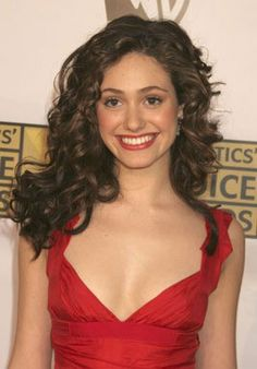 """Part of Emmy Rossum's allure is her fabulous mane of hair. This star of the much-anticipated """"Poseidon"""" has one of the most exciting heads of hair in Hollywood. Rossum keeps her tresses in shape with the right hair care products. Side Swept Curls, Emmy Rossum, Teresa Palmer, Dream Hair, Jessica Alba, Billie Piper, Woman Face, Anna Kendrick, Elizabeth Olsen"""