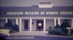 1966: American museum of atomic energy free admission signs. OAK RIDGE. http://www.pond5.com/stock-footage/58982458?ref=StockFilm keywords:Travel, tourism, visiting, learning, educational, building, history, outside, walking in, attraction, Oak Ridge, Tennessee, 1966, American, museum, atomic, energy, free, admission, signs
