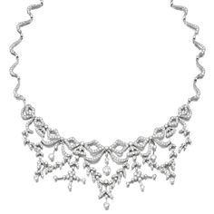 DIAMOND NECKLACE. The front designed as a series of bow motifs suspending laurel leaf and floral swags, to a back of wavy fancy links, set with brilliant-cut diamonds, length approximately 440mm, case. Edwardian or Edwardian style