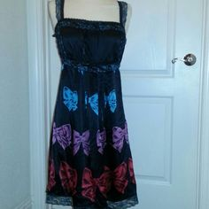 Betsey Johnson dress Black silk, red, lavander and teal bow print. Pleated bodice, black and teal lace trim. Betsey Johnson Dresses