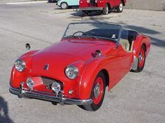 My Triumph TR2, 1956.  1998cc Straight-4 (ex-tractor!).  One of my first cars.   Another oldie but goody.  I loved it.  Shoulda kept it!