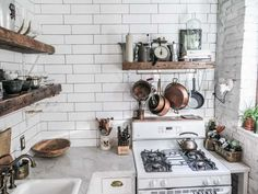 Elements of Style Blog | A Teeny TINY but Stylish Kitchen | http://www.elementsofstyleblog.com - Marble, white, wood tile