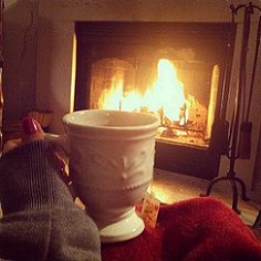 A warm blanket and tea by the fire