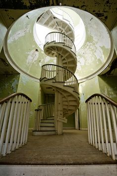Wooden spiral staircase in abandoned 1828 administrative building, Western State Hospital, Staunton, VA.