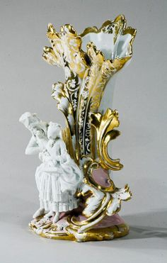 """This """"over-the top"""" pair of """"Vieux Paris"""" porcelain vases set the bar for the Rococo-style of the early 19th century"""