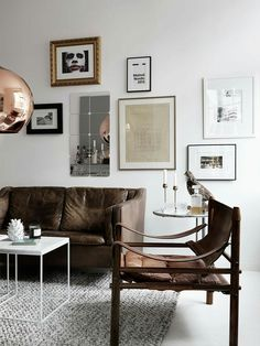 Love the vintage leather couch and safari chair!