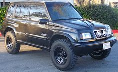 Blacked out Suzuki Sidekick