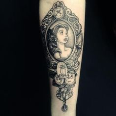 Fantastic black and grey tattoo of Belle from Beauty and the Beast.