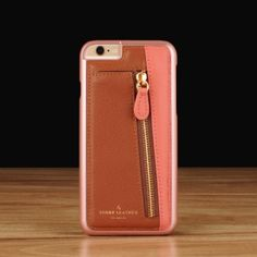 Slate Zippy for iPhone 6(s) / 6(s) Plus  Premium genuine leather Matching poly carbonate shell. Open access to all ports and buttons. Tailor made to order with your choice of leather. Free personalization in gold or silver stamping. Requires 10 business days production lead time.