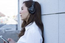 Young women are waiting for the people while listening to music