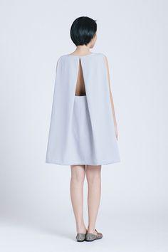 Kaarem Light Blue Grey tyh.d Boatneck Open Back Dress, $260, available at Kaarem.