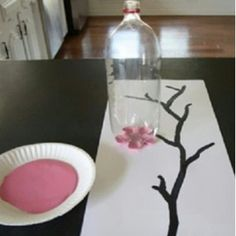 "How to DIY Paint Flowers 1. Select the desired size of pop bottle 2. Select the desired color of paint for flowers 3. Dip the bottom of the pop bottle into the paint and press onto a canvas or ""paint-friendly"" paper... This would be cute if done in shades of blues and was used for something besides a tree."