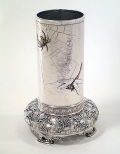 An American Gilded Age, mixed-metal vase - silver, copper, and brass, c.1874. Embellished with a gold and copper spider, an engraved spider's web, and a copper and silver dragonfly. ~ American designer: Edward C. Moore - American maker: Tiffany & Company.  ~ {cwl} ~ (Image/collection: Brooklyn Museum)