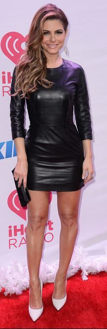 Who made Maria Menounos black long sleeve leather dress white pumps?