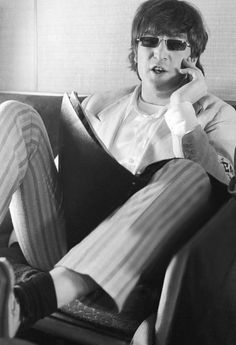 John Lennon photographed by Robert Whitaker on The Beatles' flight from Tokyo to Hong Kong, July 3, 1966