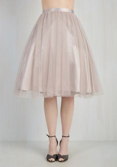 Express yourself with graceful flair in this whimsical tan skirt. Flaunting tutu-inspired layers of delicate tulle and a full, high-waisted silhouette, this statement-making number exudes elegance that's sure to raise the 'barre!'