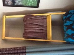 I painted an old ladder mustard yellow and have it in our living to hold blankets.