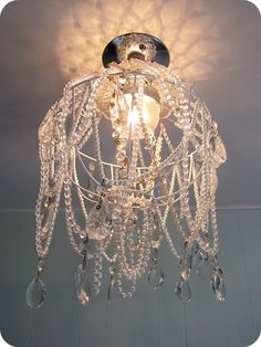 Chandelier to make for my closet ~ a wire hanging basket, crystal & pearl necklaces, glass beads, and glass teardrops.  So pretty.