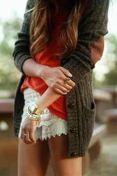 White lace shorts, orange-red tee shirt, and grandpa green knitted cardigan