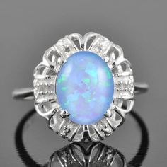 Hey, I found this really awesome Etsy listing at https://www.etsy.com/listing/92021146/opal-ring-sterling-silver-ring-oval-blue