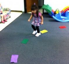 """Learn Spanish with kinesthetic lessons. This week as a review of colors, the Bilingual Fun kids did the """"Rainbow Jump""""… """"El Salto del Arcoiris."""" Each child takes a turn and says the color as they jump over each one.  It is fun and active, and the kids are producing the language while using kinesthetic abilities."""