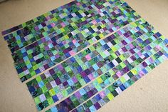 Jelly Roll Race by Peckish - finished quilt cut into strips and reassembled into Postage Stamp (http://www.quiltingboard.com/main-f1/jelly-roll-race-quilt-horrible-t192039-4.html