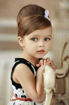 wow this little girl is beautiful! those eyes are to die for!!!