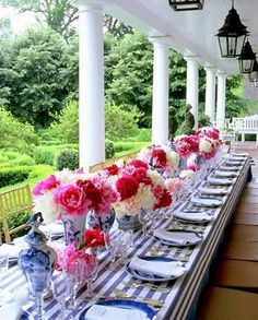 pink and white flowers, blue striped tablecloth and china vases