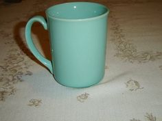 """#Corning 32 #turquoise #mug   Vintage mug in a solid turquoise color  This mug is 3 7/8"""" (9.8 cm) high x 3 1/8"""" (7.9 cm) at the brim  Made in the U.S.A. by Corning  This mug is in very good condition and only appears to have seen use as a collectible"""