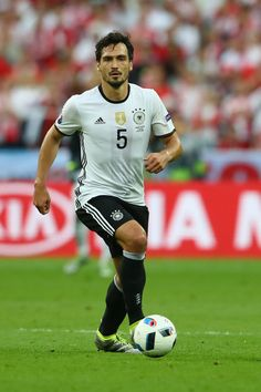 Mats Hummels of Germany runs with the ball during the UEFA EURO 2016 Group C match between Germany and Poland at Stade de France on June 16, 2016 in Paris, France.