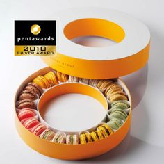 Silver Pentaward 2010 - Luxury Gourmet Food Brand: Pierre Hermé – Packaging for 24 macarons Entrant: BonnemazouCambus Country: FRANCE