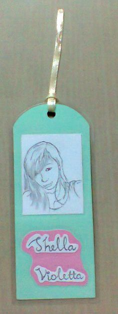 I was sketch from the potrait. Then adding her name.