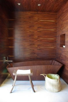 Dark Wooden Bathtub | This dark walnut bathtub will surely stand out in the bathroom and create a wondrous and splendid ambiance. The wooden bathtub experience will surely add a huge modern statement in the bathroom. | To see more Luxury Bathroom ideas visit us at www.luxurybathrooms.eu #luxurybathrooms #homedecorideas #bathroomideas @BathroomsLuxury